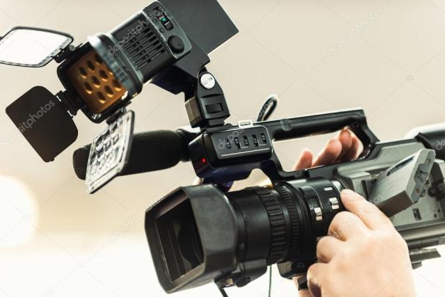 TV journalist-holding-portable-tv-camera